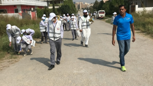 12- Students cleaning roads